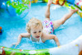Little blondie girl in swimming pool Stock Photo