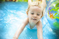 Little blondie girl in swimming pool Royalty Free Stock Photos