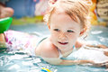 Little blondie girl in the swimming pool Royalty Free Stock Photo