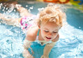 Little blondie girl in the swimming pool Royalty Free Stock Image