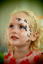 Little blue eyed girl face painting Royalty Free Stock Photo