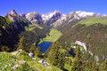 Little blue lake in the Swiss Alps Stock Photos