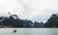 Little boat the small tail machine bring group of tourist to another side of mountain khao sok suratthanee thailand Stock Image