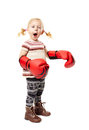 Little boxer girl with huge red boxing gloves pulling faces Royalty Free Stock Photo
