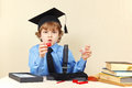 Little boy in academic hat with the jars for research next to microscope Royalty Free Stock Photo