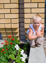 Little boy against yellow brick wall Royalty Free Stock Photo