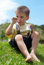 The little boy is appetizing eats yoghurt Royalty Free Stock Images