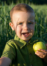 Little boy with apple Royalty Free Stock Photos