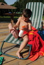 Little boy applying sunscreen lotion Royalty Free Stock Photos