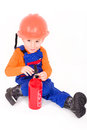 Little boy as a firefighter with fire extinguisher powder optional Royalty Free Stock Photos