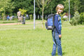 Little boy with a backpack go to school. Back view Royalty Free Stock Photo