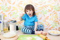 Little boy bakes sitting on a table at home kitchen years Stock Images