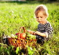 Little boy with a basket of fruit Stock Image