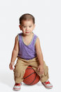 Little boy with basketball isolated over white Royalty Free Stock Image