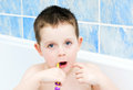 Little boy in the bath tub brushing his teeth Royalty Free Stock Photography