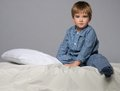 Little boy in bed wearing blue pyjamas Royalty Free Stock Photo