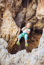 Little boy being lowered down while top rope climbing Royalty Free Stock Photo