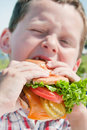 Little boy, big burger Stock Photo