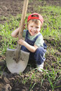 Little boy with big shovel Stock Photography