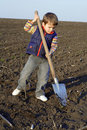 Little boy with big shovel Royalty Free Stock Photo