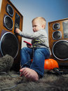 The little boy and the big sound system Royalty Free Stock Photo
