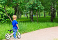 Little boy with bike in the park early learning concept Royalty Free Stock Photography
