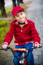 Little boy with bike at park smiling on in Stock Image