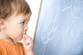 Little boy biting chalk looking blackboard preschool over white Royalty Free Stock Photography
