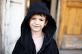 Little boy in black bathrobe drying outdoor Royalty Free Stock Images