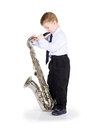Little boy black trousers white shirt costs saxophone hands Stock Photography