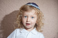 The little boy with blond curls in Jewish skullcap Royalty Free Stock Photo