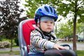 Little boy with blue helmet on bicycle Royalty Free Stock Image
