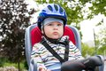 Little boy with blue helmet on bicycle Stock Photos