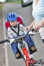 Little boy with blue helmet on bicycle with mother Stock Photos