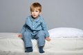 Little boy in blue pyjamas wearing bed Royalty Free Stock Photography