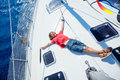 Little boy on board of sailing yacht on summer cruise. Travel adventure, yachting with child on family vacation. Royalty Free Stock Photo