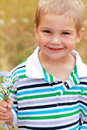 Little boy with bouquet of flowers. Stock Photos