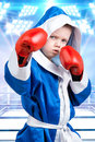 Little boy boxer with red gloves and robe in the background of the ring.Little champion.The big wins. Royalty Free Stock Photo