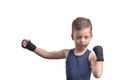 Little boy boxing, shows his fists, isolated on white Royalty Free Stock Photo