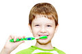 Little boy brushing her teeth Stock Photo