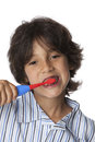 Little boy is brushing his teeth on white background Royalty Free Stock Photos