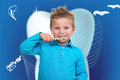 Little Boy Brushing Teeth with dental background Royalty Free Stock Photo