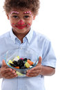 Little boy with candy made up as a clown bowl of Stock Photos