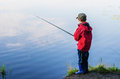A little boy catches a fish Royalty Free Stock Photo