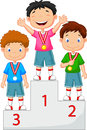 Little boy celebrates his golden medal on podium