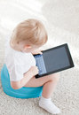 Little boy chamder tablet pc white carpet Royalty Free Stock Image