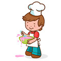 Little boy chef messy cooking a wearing a uniform something delicious and making a mess Royalty Free Stock Image
