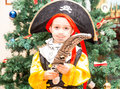 Little boy child dressed as pirate for Halloween  on background of Christmas tree Royalty Free Stock Photo
