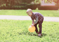 Little boy child playing with ball outdoors on the grass Royalty Free Stock Photo