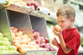 Child boy choosing fruits vegetable shopping Royalty Free Stock Photo